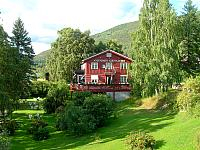 Amundsen Hotel has a large veranda and a beautiful garden next to the river