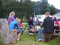 in the evening our guests sociable grill marshmellows on the fire in the