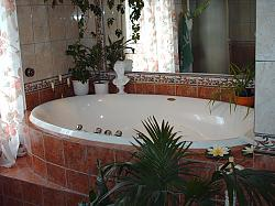 Enjoy bubblebath and steam shower in our large, tiled bathroom.